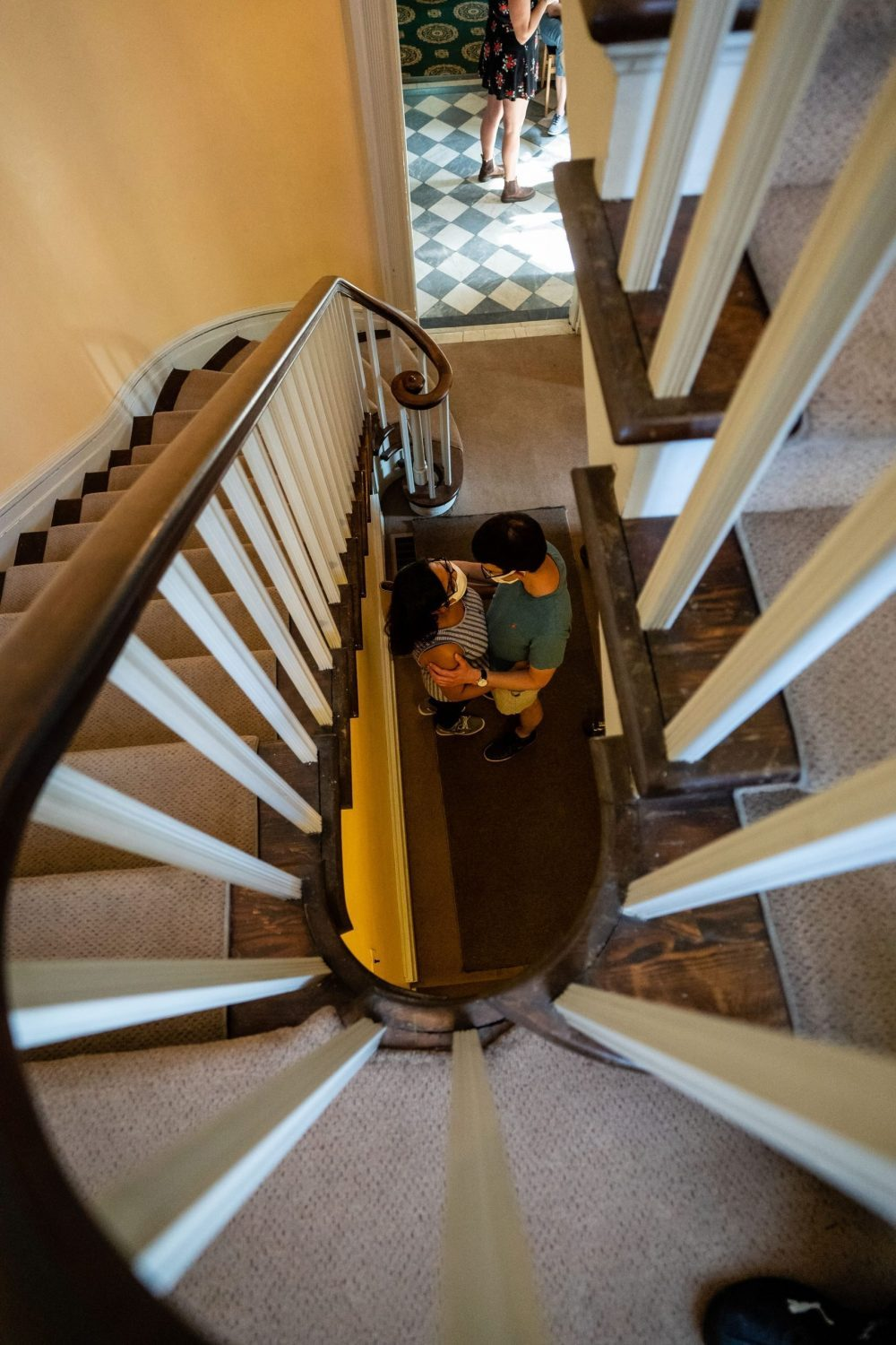stairwell hugs couple with masks