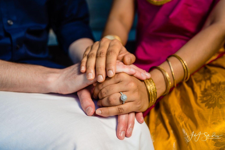 holding hands wedding rings bracelets gold