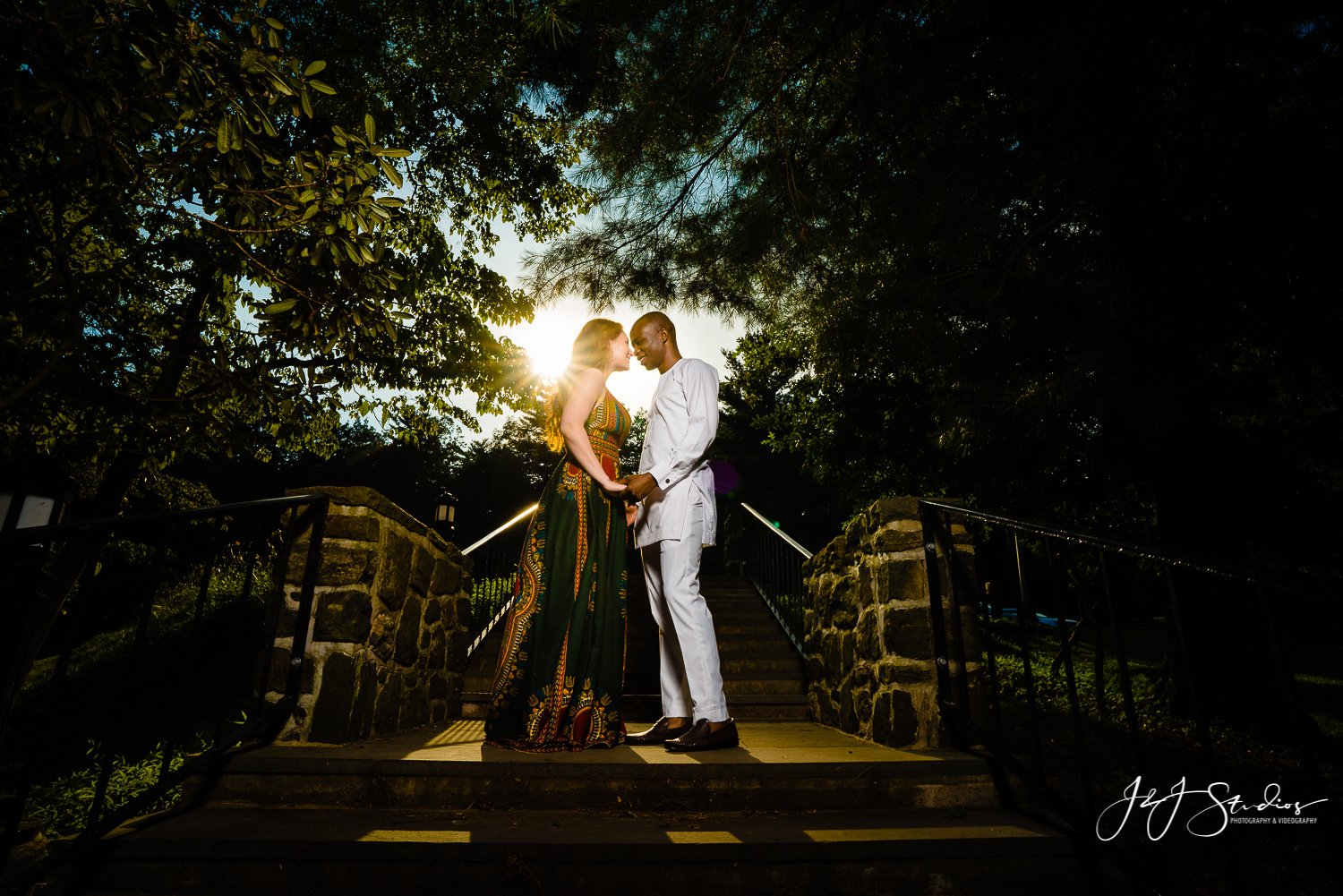 sunlight beaming in through trees woman man engaged stairs