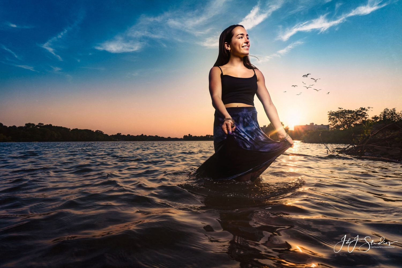 Girl sitting lake waves skies birds senior picture New Jersery