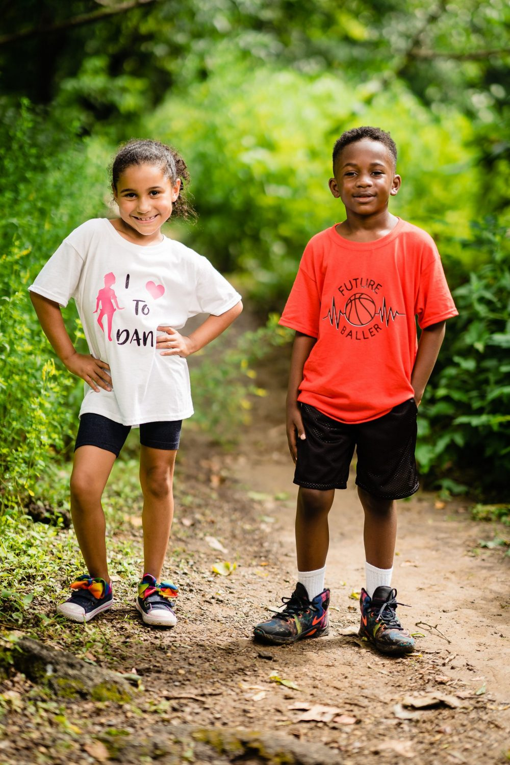 young boy and girl modeling clothing