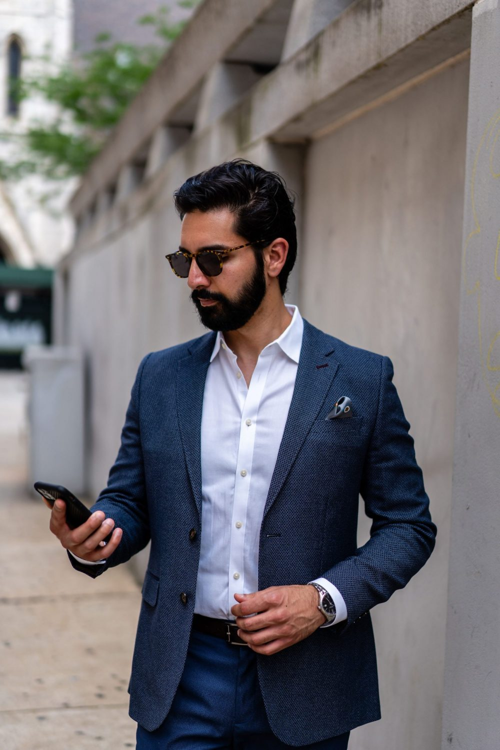 Male model with sunglasses and cellphone
