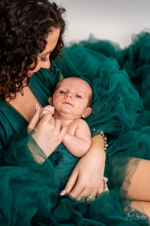 green gown newborn photoshoot baby happy