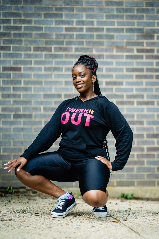 girl kneeling in a long sleeve t-shirt